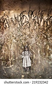 Horror Scene with scary little girl in a corn field