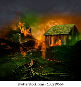 Horror Scene ~ Scary Mountain Graveyard With Tomb Stone, Haunted House, Orange Full Moon And Twisted Dead Tree Roots Burning In The Evil Green Fog Of A Dark Stormy Night
