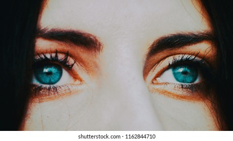 Horror scene of a scary woman, close up of scary eyes