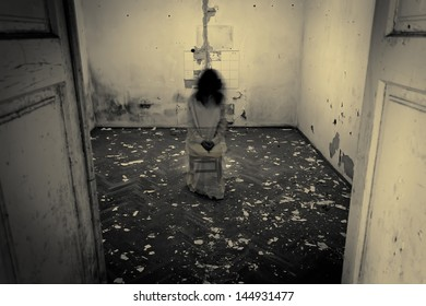 Horror scene of a scary woman in the dark room