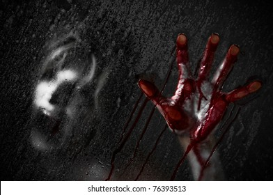 Horror Scene of a Woman with Bloody Hand against Wet Shower Glass