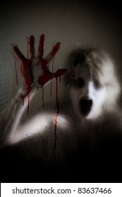 Horror Scene of a Woman with Bloody Hand against Wet Shower Glass Focus is on Glass