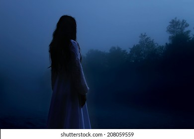 Horror scene of the Woman Ghost in White Dress
