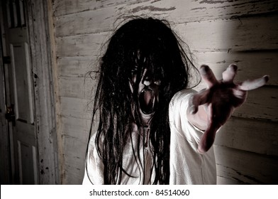 Horror Scene of a Woman Possessed Screaming