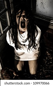 Horror Scene of a Woman Possessed Wearing a Straight Jacket Screaming