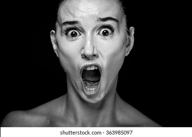 Horror Scene of a Woman Screaming on black background
