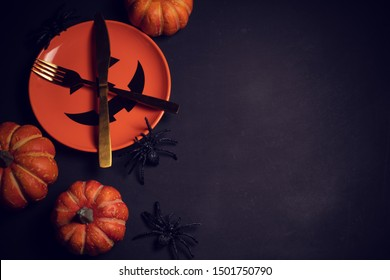 horror spooky funny ghost in halloween pumpkin holiday season greeting night celebration party with toy prop decoration in top view flatlay and trick of treat festival concept