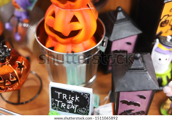 horror spooky funny ghost in halloween pumpkin holiday season greeting night celebration party with toy prop decoration and trick of treat festival concept
