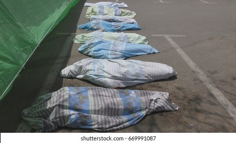 Horror view of dead corpses of mannequins, wrapped in hospital sheets, lie in parking lot morgue at Haemek Hospital during drill. Afula, Israel, April 27th, 2017.