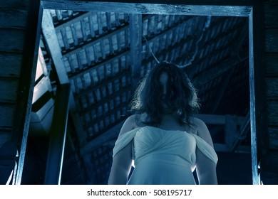 horror woman standing door entrance scary scene tilt frame halloween concept flare lighting on background