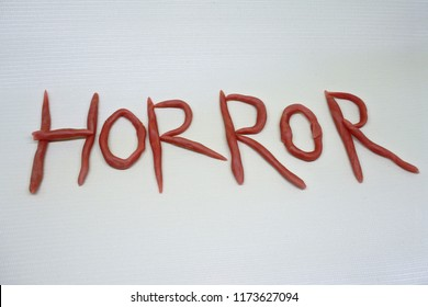 horror word in clay
