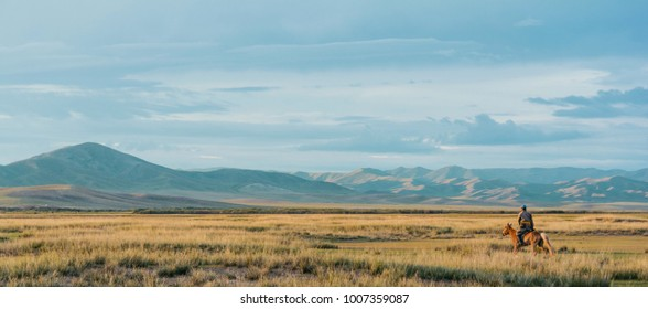 Horse back rider in the Mongolian landscape