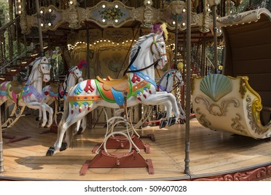 horse carousel / horse colored wood of a vintage carousel with lights and colors, game for children and family, front view
