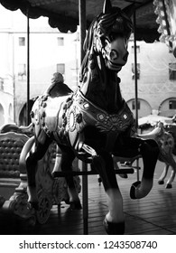 Horse carousel in Italy. Black and white photo.
