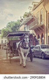A horse and carriage in the French Quarter, New Orleans, Louisiana with vintage retro filter effect