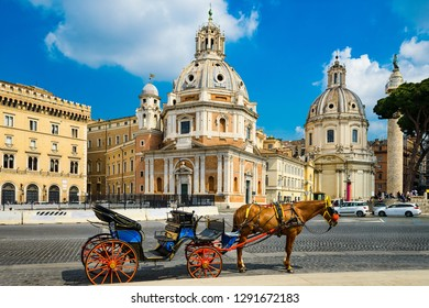 Horse carriage in front of historic buildings in Rome, Italy