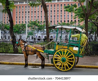 Horse with carriage in Intramuros, Manila, Philippines. Intramuros is the oldest district and historic core of Manila capital of the Philippines.