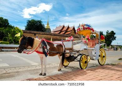 Horse carriage at Phrathat Lampang Luang temple in Lampang, Thailand
