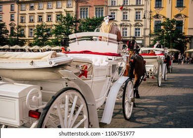 Horse crew in the old town. Krakow main square, horses, coachman. concept car in the city. a girl in a hat in a carriage. coach in the city