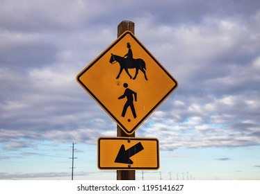 horse crossing road sign or horse warning sign by the street. A pedestrian crossing or crosswalk.