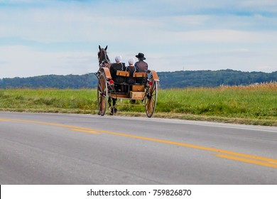 Horse drawn Amish buggy traveling down Pennsylvania road