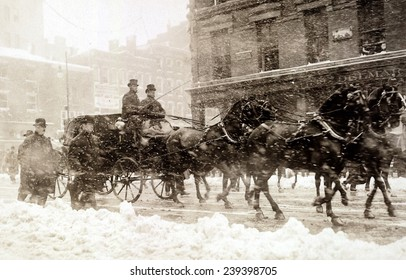 Horse drawn carriage carrying incoming President Taft, and Presiednt Theodore Roosevelt as they drive to the Capitol through the snow on March 4, 1909.