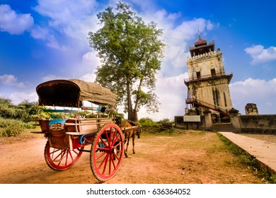 Horse Drawn Carriage parking in front of Nanmyin watchtower in Inwa ancient city, Mandalay Myanmar. Nanmyin watchtower is one of the most famous tourist destination in Mandaylay.