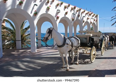 Horse drawn carriages along the Balcony of Europe (Balcon de Europa), Nerja, Costa del Sol, Malaga Province, Andalusia, Spain, Western Europe.