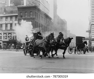 Horse drawn fire engine speeds on West 43rd Street and Broadway, NYC, 1910-15. The steam is from the engines boiler which powered a pump to spray on the fire