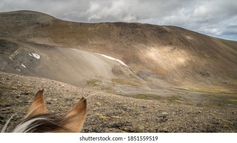 Horse ears perspective of a barren scree landscape in the alpine. (BC, Canada)