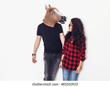 Horse head man and pretty girl looking at each other