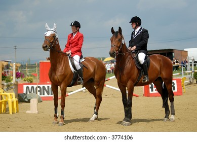 horse jumping riders