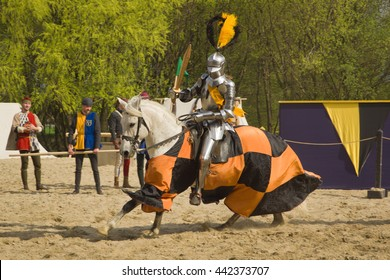 The horse knights in an armour and in a helmet with a sword in a hand. St.George knightly tournament. Moscow on May 1, 2016