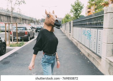 horse mask young woman in the city