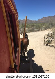 horse pulling stagecoach in desert