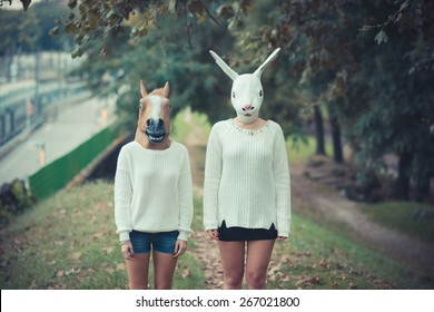horse and rabbit mask young couple beautiful women girls autumn outdoor