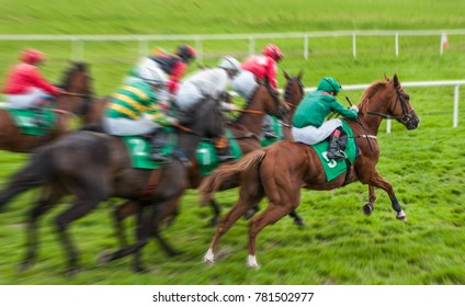 Horse race gallop motion blur at start of race