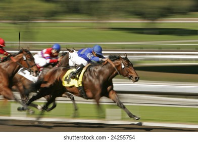 Horse race shot at slow shutter speed to enhance motion effect