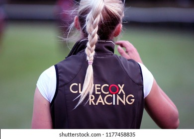 HORSE RACING - Girl with blonde plaited hair wearing Clive Cox Racing jacket at Nottingham Races : Colwick Park, Nottingham, UK : 7 August 2018