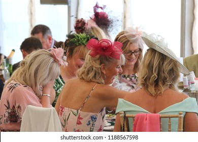 HORSE RACING - Group of women laughing enjoy social atmosphere and occasion of Thirsk Races Ladies Day : Thirsk Racecourse, Nth Yorkshire, UK : 8 September 2018