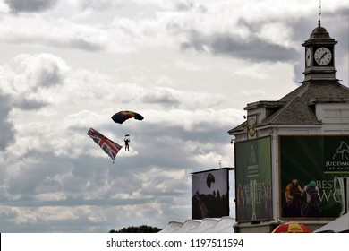 HORSE RACING - The Silver Stars Parachute Display Team arrive in the skies over the racecourse near The Clock Tower : York Racecourse, Nth Yorkshire, UK : 25 August 2018