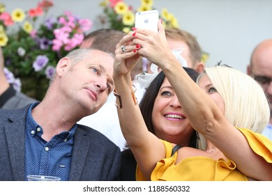 HORSE RACING - Three people pose and take selfie on mobile smartphone at Thirsk Races : Thirsk Racecourse, Nth Yorkshire, UK : 8 September 2018 : Pic Mick Atkins