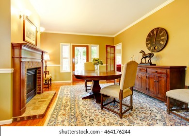 Horse ranch dining room with fireplace and wooden cabinet. Northwest, USA