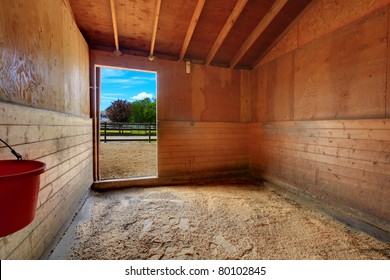 Horse ranch in Washington State, US. Open door at the barn's stable.