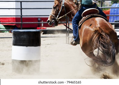 A horse and rider barrel racing at a rodeo.