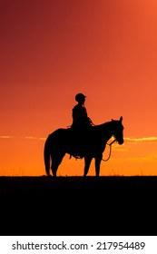 Horse rider silhouette at sunset