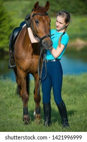 Horse rider woman near stable, horsewoman before training outdoors