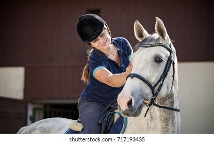 Horse rider woman near stable, horsewoman before training