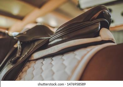 Horse Riding Equipment. Elegant Saddle and White Pad. Equestrian Facility.