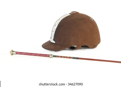 Horse riding helmet and crop